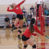 "Claire Henning goes airborne before nailing a spike in the varsity volleyball team's 3-1 home win over Upper Columbia Academy on Friday, Sept. 8.  See a Photo Gallery of the girls' serves, sets, spikes and celebrations at <a href=""https://saintgeorges.smugmug.com/Athletics/US-Volleyball-vs-UCA-9-8-17/"">https://saintgeorges.smugmug.com/Athletics/US-Volleyball-vs-UCA-9-8-17/</a>"