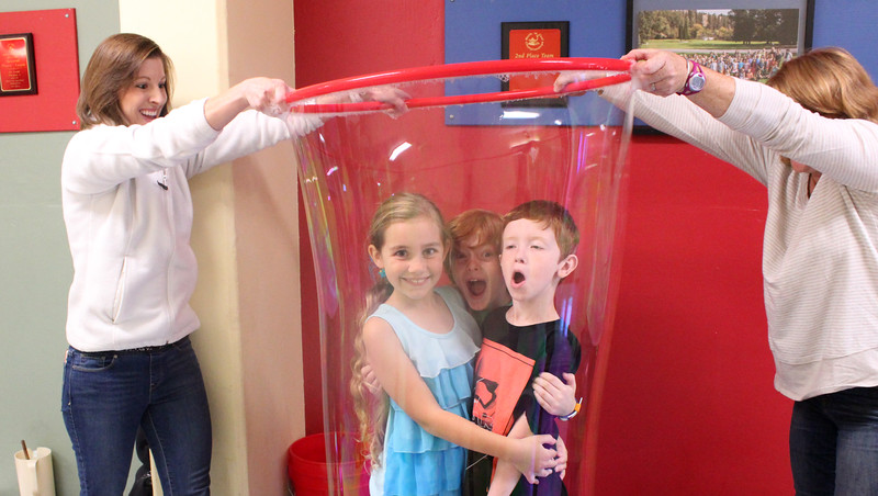 "What is more surprising than to be enveloped in a giant bubble?  Being enveloped in one with your friends!  That's what our 2nd graders experienced at their annual Bubble Festival on Sept. 29.  See more photos from this fun exploration of the science of thin surfaces at:  <br /> <a href=""https://saintgeorges.smugmug.com/Academics/2nd-Grade-Bubbles-9-29-17/"">https://saintgeorges.smugmug.com/Academics/2nd-Grade-Bubbles-9-29-17/</a>"