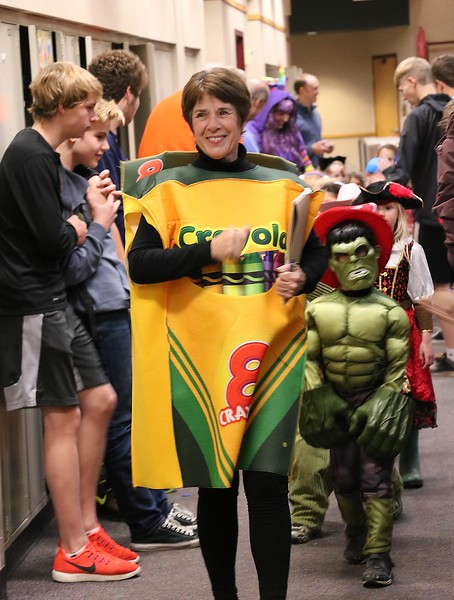 Lower School head Kathy Johnson leads the annual Halloween Costume Parade through the Upper School the afternoon of October 31st.