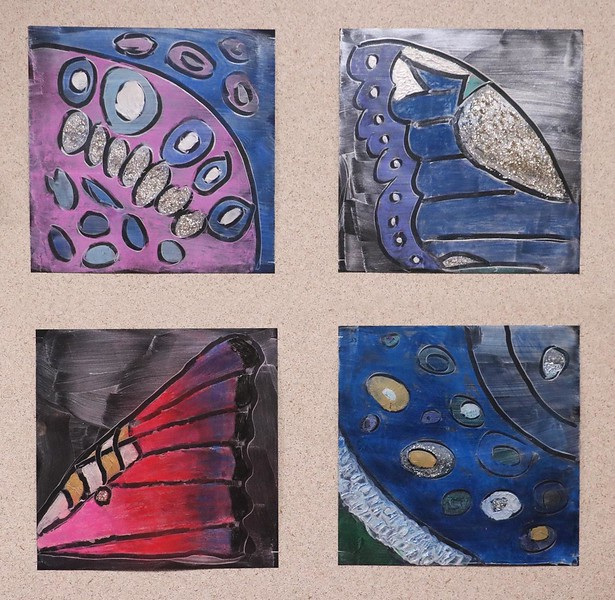 The Middle School walls are covered with student artwork, from bold names and cardboard puppies to bright prints and inspired sayings.  These 8th grade mixed media butterfly wings are in the style of Georgia O'Keefe.