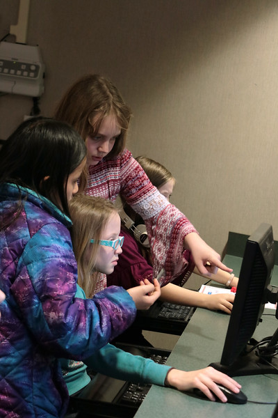 """Students help each other during the Lower School Coding Club, which meets Thursdays after school to learn simple programming language needed to create their own video games.  See more photos from the class at <br /> <a href=""""https://saintgeorges.smugmug.com/Academics/LS-Coding-Club-3-8-18"""">https://saintgeorges.smugmug.com/Academics/LS-Coding-Club-3-8-18</a>"""