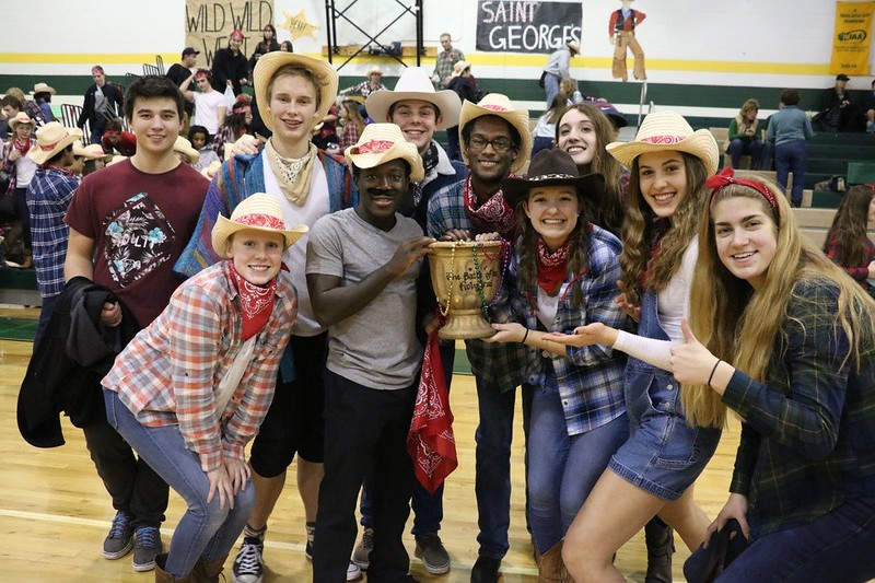Saint George's seniors celebrate winning the Battle for the Holy Grail at Northwest Christian on Friday, Jan. 27.