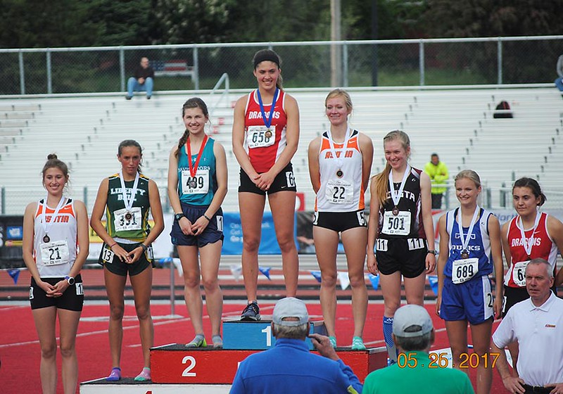 """Senior Madison Ward closed out her running career at Saint George's with a pair of individual State Championships.  She won the 1,600 meter race on Thursday, May 25 in 5:16.16, more than five seconds ahead of the next runner from Northwest Christian.  Then on Saturday, May 27, Madison finished the 800 meter race in a near state-record time of 2:20.25, the fourth time she has taken the State title in that distance.  See more photos from the 1B/2B/1A State Track and Field Championships at <a href=""""https://saintgeorges.smugmug.com/Athletics/US-Track-at-State-5-25-to-5-27-17/"""">https://saintgeorges.smugmug.com/Athletics/US-Track-at-State-5-25-to-5-27-17/</a>"""