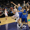 "Lydia Bergquist eludes the long arms of Colfax defenders on her way to a basket in the State 2B Tournament. The girls team finished the tournament 3-1 with the 3rd place trophy while the boys took 2nd in State. See more photos of the girls and boys teams at State at <a href=""https://saintgeorges.smugmug.com/Athletics"">https://saintgeorges.smugmug.com/Athletics</a>"