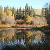 "An October morning's stillness reflects off the Little Spokane's smooth surface.  See two photo galleries of autumn colors on the Saint George's campus at <a href=""https://saintgeorges.smugmug.com/Community"">https://saintgeorges.smugmug.com/Community</a>"