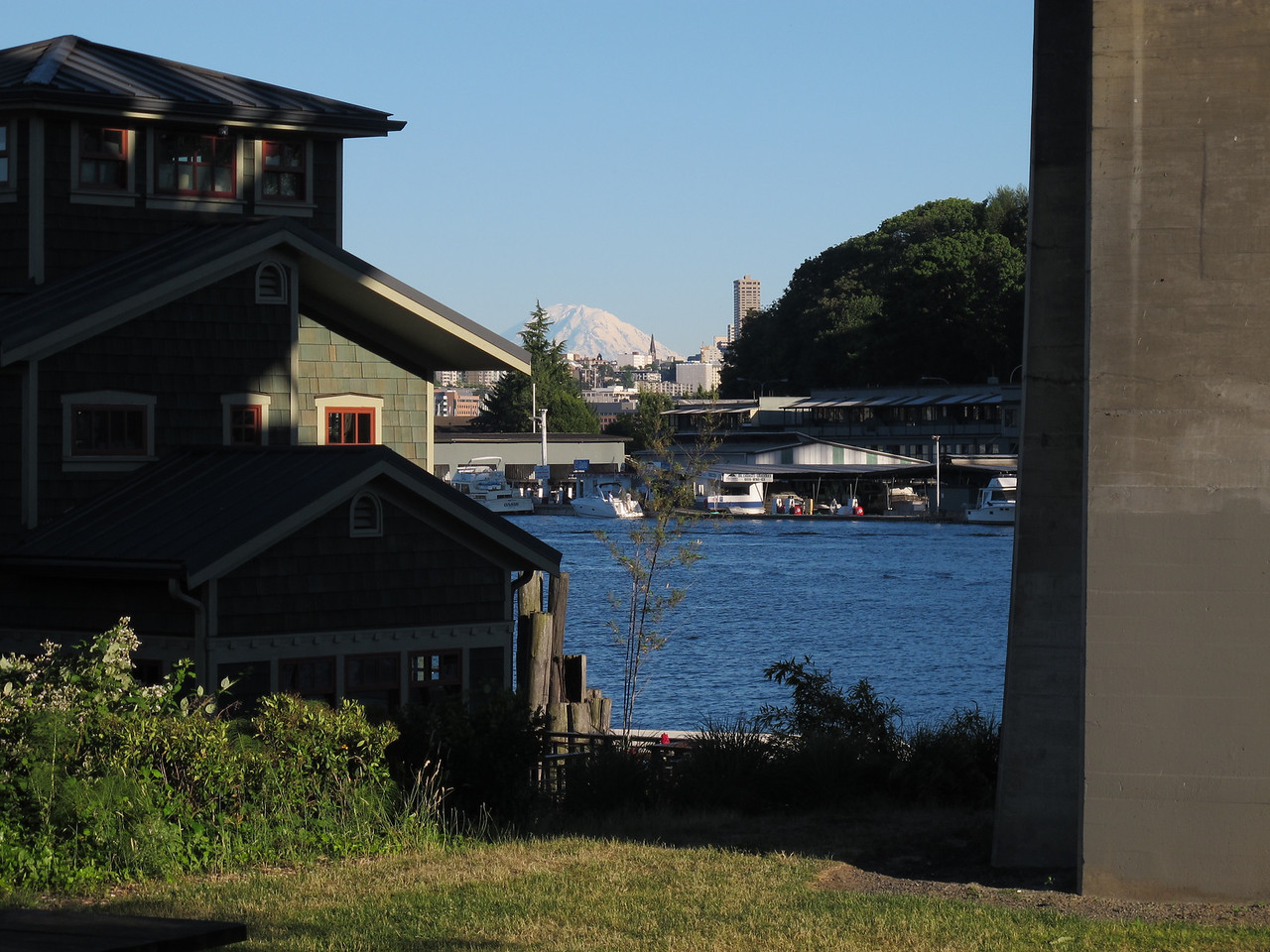 Tuesday, July 5, 2011. Mt. Rainer straddled between a housebout and a pillar of the Highway 99 bridge in Fremont, Seattle.
