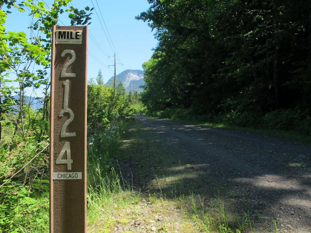 Saturday, July 23, 2011. We ride the Iron Horse Trail. A railroad right-of-way converted to the bicycle trail, it takes you across Snoqualmie Pass to Eastern Washington. This is a route marker that shows the distance to Chicago.