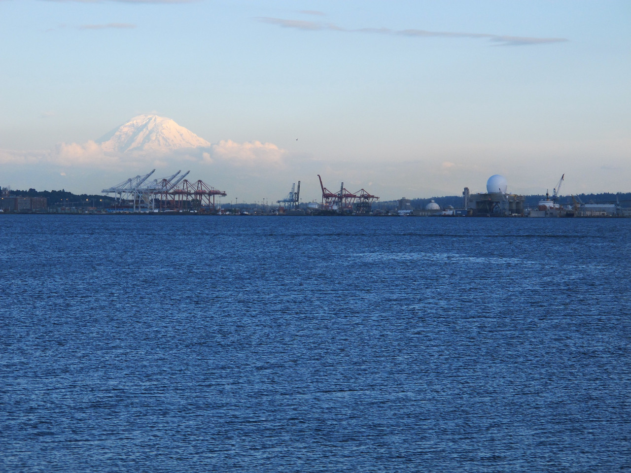 Saturday, June 25, 2011. Mt. Rainier looms over the Port of Seattle. This was the view after a 60 mile ride in preparation for this year's Seattle to Portland bicycle ride in two weeks.<br /> <br /> The Domed structure on the right is a platform that is used by the US Missile Protection System. It is being refurbished in Seattle. The dome houses an extremely sensitive phased array radar. This platform is self propelled and is normally situated close to trouble spots that pose a missile threat to the US or it's allies.