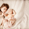 Girl with newborn brother