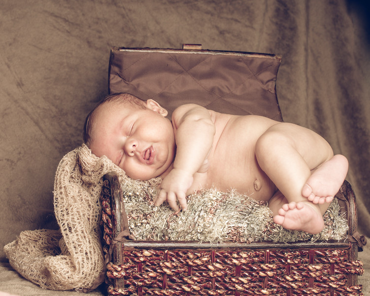 New Born Baby Sleeping inside wooden basket or box