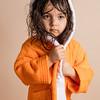 Small girl in Orange towel