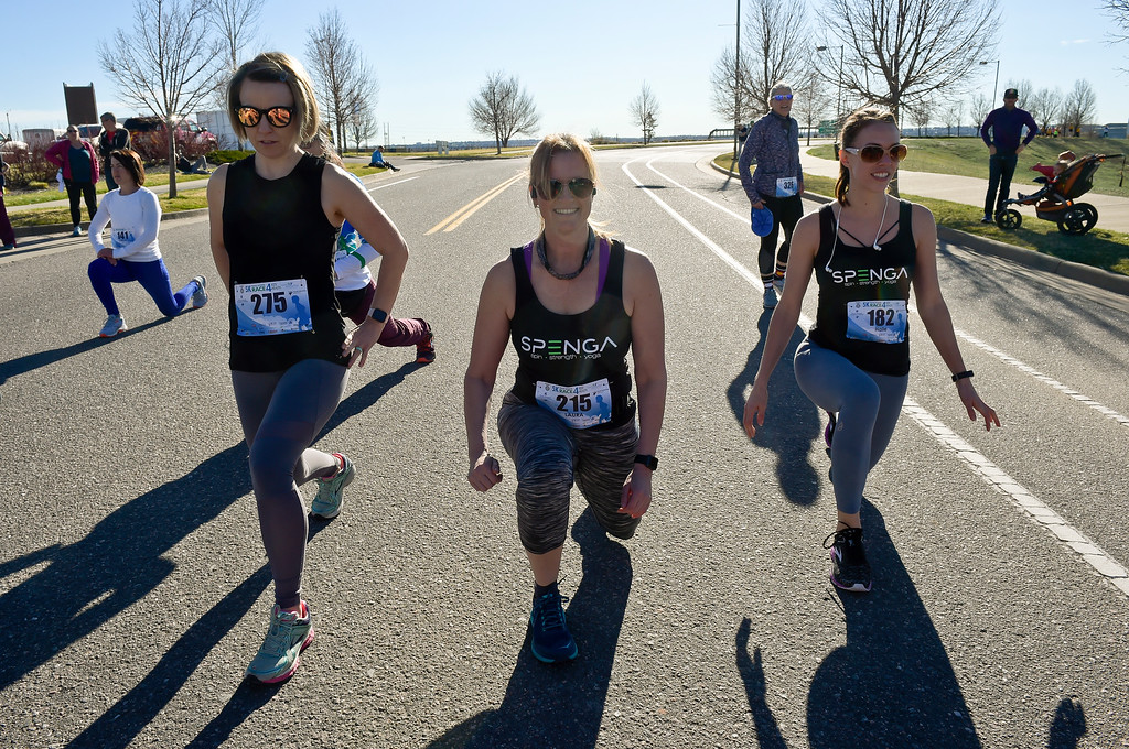 . BROOMFIELD, CO - APRIL 7: From left: Kristy Cook, Laura Pappalardo, and Halie Kurtenbach warm up for the Frank Shorter RACE4Kids\' Health 5K & Expo at the 1st Bank Center April 7, 2019. RACE4Kids was celebrating its 10th anniversary. To view more photos visit dailycamera.com. (Photo by Lewis Geyer/Staff Photographer)