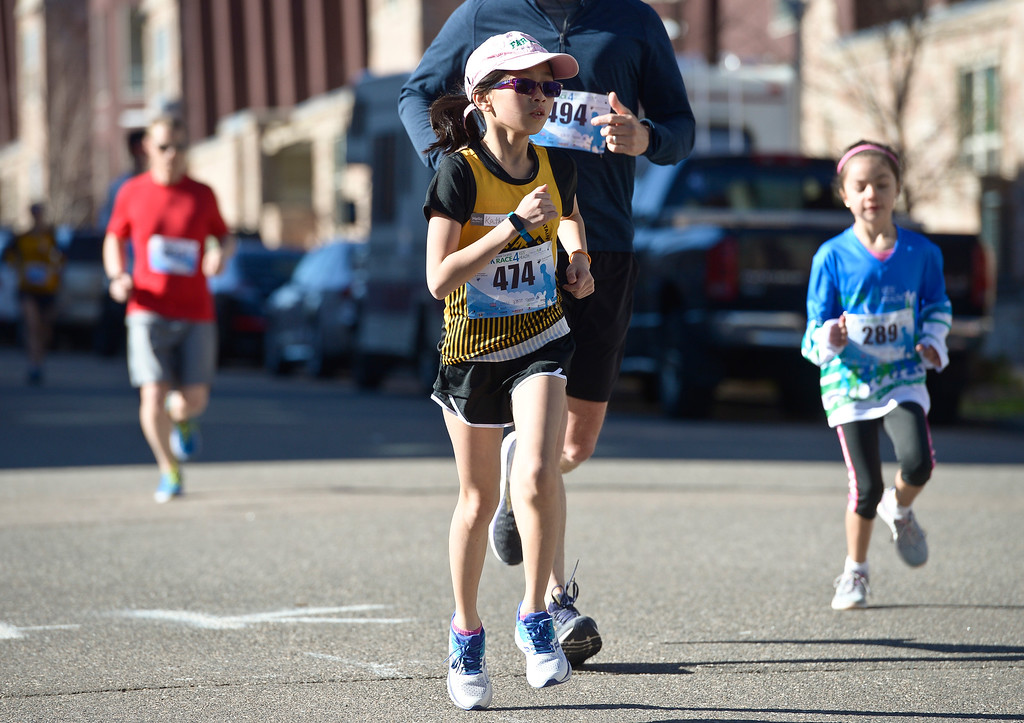 . BROOMFIELD, CO - APRIL 7: Kathryn McCaig, 11, runs in the Frank Shorter RACE4Kids\' Health 5K & Expo at the 1st Bank Center April 7, 2019. RACE4Kids was celebrating its 10th anniversary. To view more photos visit dailycamera.com. (Photo by Lewis Geyer/Staff Photographer)