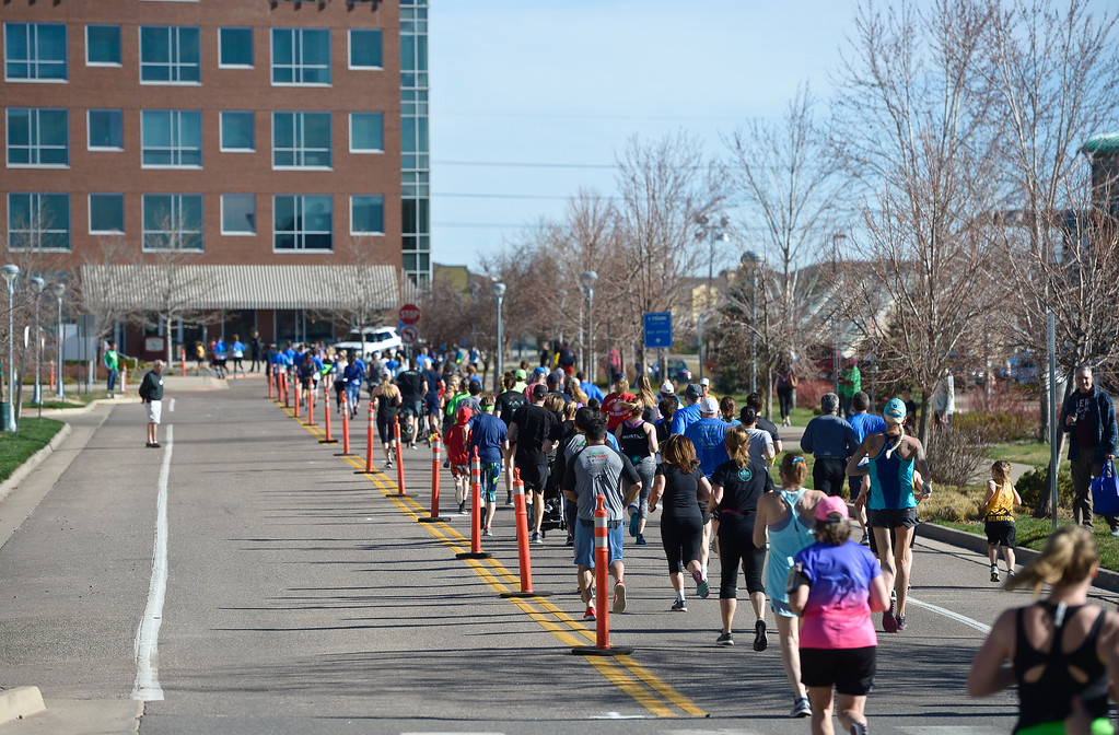 . BROOMFIELD, CO - APRIL 7: Racers run down Broomfield Lane during the Frank Shorter RACE4Kids\' Health 5K & Expo at the 1st Bank Center April 7, 2019. RACE4Kids was celebrating its 10th anniversary. To view more photos visit dailycamera.com. (Photo by Lewis Geyer/Staff Photographer)
