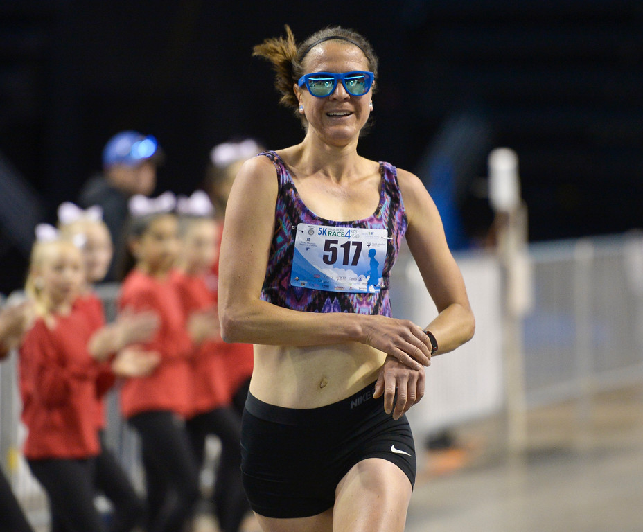 . BROOMFIELD, CO - APRIL 7: Eva Krchova is the first woman across the finish line at the Frank Shorter RACE4Kids\' Health 5K & Expo at the 1st Bank Center April 7, 2019. RACE4Kids was celebrating its 10th anniversary. To view more photos visit dailycamera.com. (Photo by Lewis Geyer/Staff Photographer)