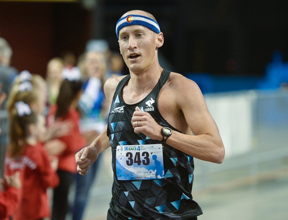 . BROOMFIELD, CO - APRIL 7: Tyler McCandless crosses the finish line in first place at the Frank Shorter RACE4Kids\' Health 5K & Expo at the 1st Bank Center April 7, 2019. RACE4Kids was celebrating its 10th anniversary. To view more photos visit dailycamera.com. (Photo by Lewis Geyer/Staff Photographer)