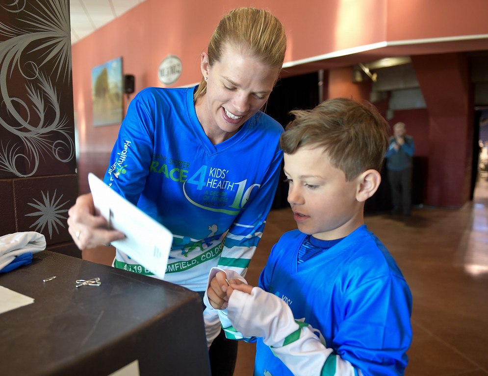 . BROOMFIELD, CO - APRIL 7: Valerie Stubbs and her son Eli, 9, prepare for the Frank Shorter RACE4Kids\' Health 5K & Expo at the 1st Bank Center April 7, 2019. RACE4Kids was celebrating its 10th anniversary. To view more photos visit dailycamera.com. (Photo by Lewis Geyer/Staff Photographer)
