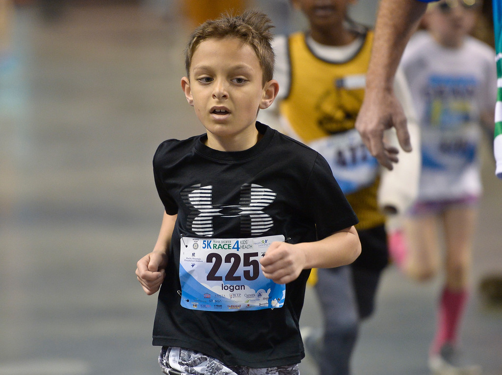 . BROOMFIELD, CO - APRIL 7: Logan Shaltakoff, 8, crosses the finish line at the Frank Shorter RACE4Kids\' Health 5K & Expo at the 1st Bank Center April 7, 2019. RACE4Kids was celebrating its 10th anniversary. To view more photos visit dailycamera.com. (Photo by Lewis Geyer/Staff Photographer)