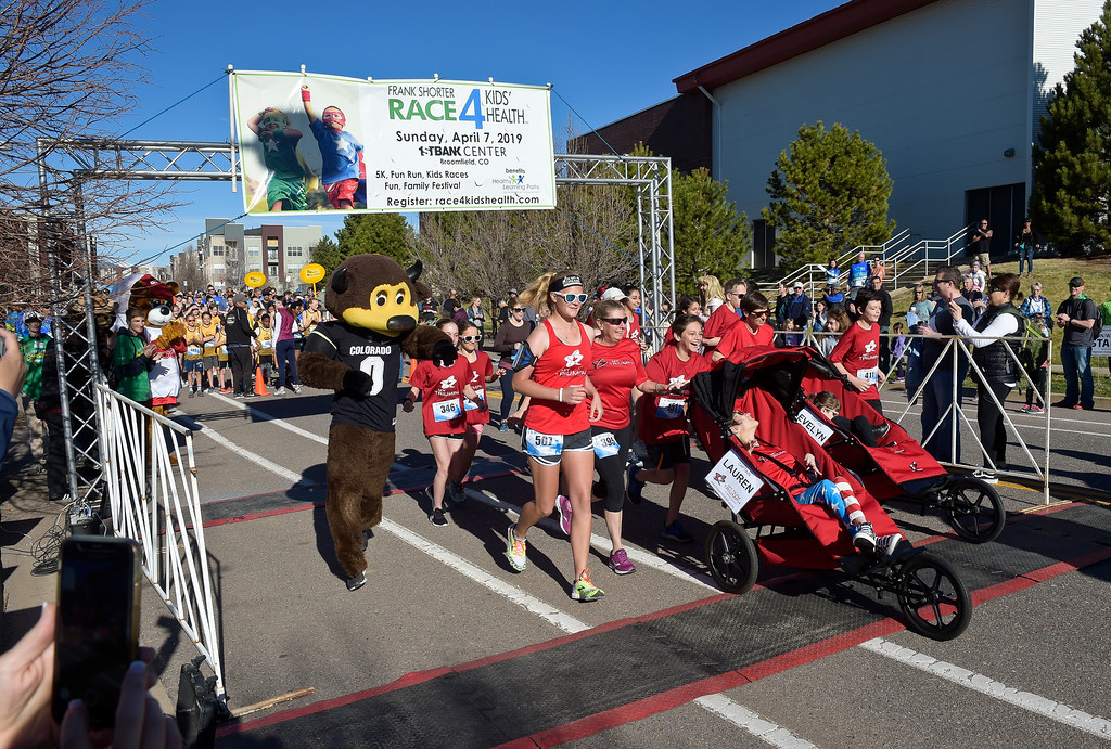 . BROOMFIELD, CO - APRIL 7: My Team Triumph gets a head start at the Frank Shorter RACE4Kids\' Health 5K & Expo at the 1st Bank Center April 7, 2019. RACE4Kids was celebrating its 10th anniversary. To view more photos visit dailycamera.com. (Photo by Lewis Geyer/Staff Photographer)