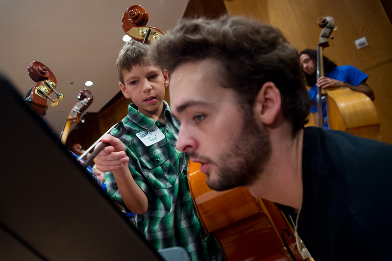 "CU student Chris Baechtel (right) helps Joseph Coppa, 11, during rehearsal for the 14th Rocky Mountain Bass Festival at CU's Imig Music Building on Sunday.<br /> More photos:  <a href=""http://www.dailycamera.com"">http://www.dailycamera.com</a><br /> (Autumn Parry/Staff Photographer)<br /> October 2, 2016"