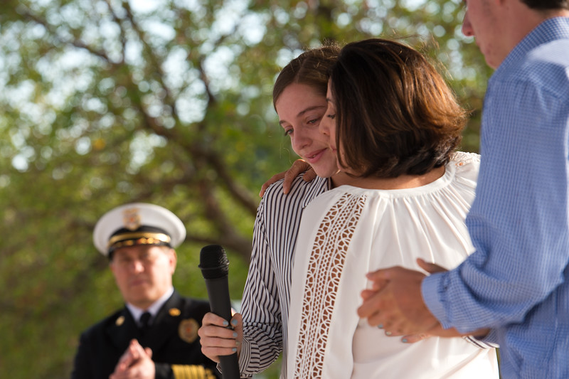 "Siena Faughnan receives a hug from her mother, Cathy, after she gave a speech about her father, Chris Faughnan, who was among those killed in the terrorist attacks fifteen years ago, during a 9/11 memorial ceremony at the Broomfield Amphitheater on Sunday.<br /> More photos:  <a href=""http://www.dailycamera.com"">http://www.dailycamera.com</a><br /> (Autumn Parry/Staff Photographer)<br /> September 11, 2016"