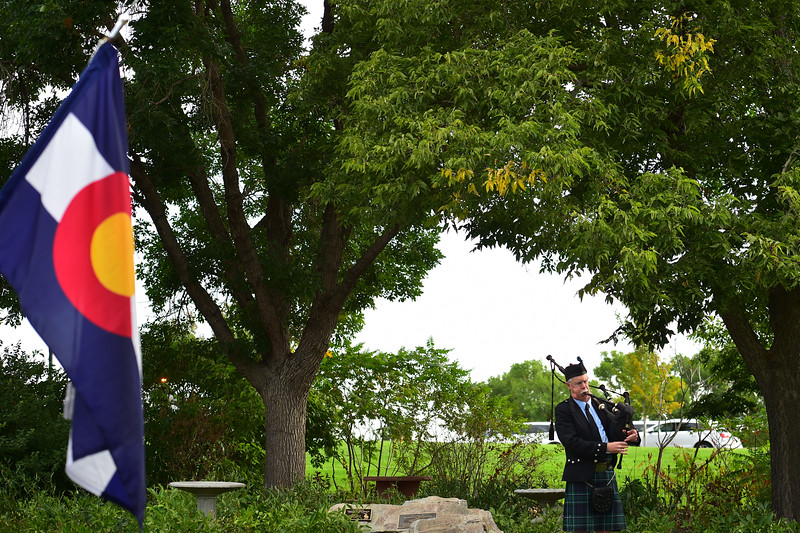 "A piper plays the bagpipes during the annual memorial ceremony at the 9/11 Memorial in Broomfield on Sunday. <br /> More photos:  <a href=""http://www.dailycamera.com"">http://www.dailycamera.com</a><br /> (Autumn Parry/Staff Photographer)<br /> September 11, 2016"