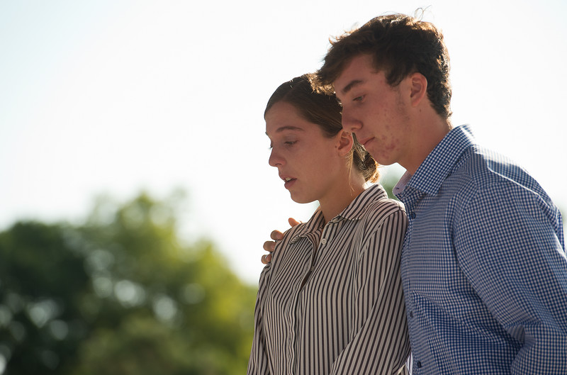 """Siena Faughnan stands with her brother, Liam, as they listen to their mother speak about their father, Chris Faughnan, who was among those killed in the terrorist attacks fifteen years ago, during a 9/11 memorial ceremony at the Broomfield Amphitheater on Sunday.<br /> More photos:  <a href=""""http://www.dailycamera.com"""">http://www.dailycamera.com</a><br /> (Autumn Parry/Staff Photographer)<br /> September 11, 2016"""