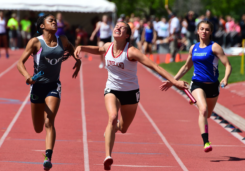 . Josie Eder, center,  of Loveland, runs in the 4X100 meter relay during the Colorado State Track and Field Championships on Saturday at Jeffco Stadium. For more photos, go to www.bocopreps.com. Cliff Grassmick  Staff Photographer  May 21, 2016