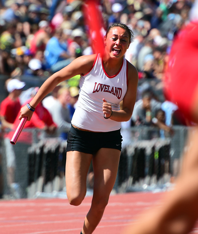 . Tatum Rembao, of Loveland, runs in the 4X100 meter relay during the Colorado State Track and Field Championships on Saturday at Jeffco Stadium. For more photos, go to www.bocopreps.com. Cliff Grassmick  Staff Photographer  May 21, 2016