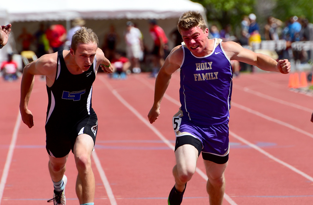 . Trevor Cook, left, of Longmont, and Will Domier, of Holy Family, battle in the 100 meters during the Colorado State Track and Field Championships on Saturday  at Jeffco Stadium. For more photos, go to www.bocopreps.com. Cliff Grassmick  Staff Photographer  May 21, 2016