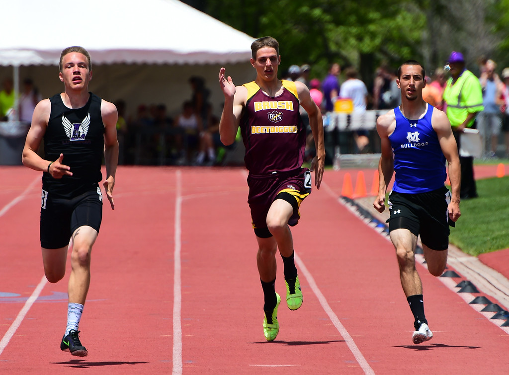 . Reid Hall, center, of Brush, competes in the 200 meters during the Colorado State Track and Field Championships on Saturday at Jeffco Stadium. For more photos, go to www.bocopreps.com. Cliff Grassmick  Staff Photographer  May 21, 2016