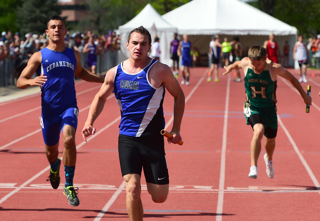 . Cooper Ward , of Resurrection Christian, finishes the 4X100 relay for his winning teammates during the Colorado State Track and Field Championships on Saturday at Jeffco Stadium. For more photos, go to www.bocopreps.com. Cliff Grassmick  Staff Photographer  May 21, 2016
