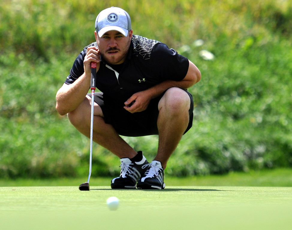 Josh McLaughlin eyes his putt during the 2017 Loveland City Championship on Sunday Aug. 20, 2017 at Mariana Butte. (Cris Tiller / Loveland Reporter-Herald)