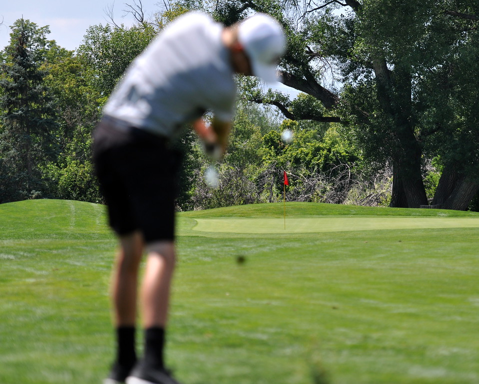 Thompson Valley's Darren Edwards shoots for the pin during the 2017 Loveland City Championship on Sunday Aug. 20, 2017 at Mariana Butte. (Cris Tiller / Loveland Reporter-Herald)