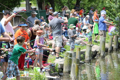 Charles Pritchard - Oneida Daily Dispatch Children of all ages try to prove their skills as an angler at the 68th Annual Sherrill Kids Fishing Derby on Saturday, June 9, 2018.