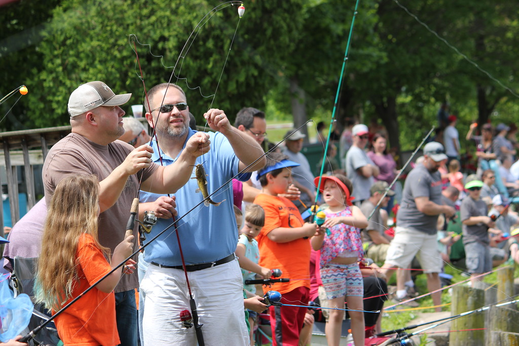 . Charles Pritchard - Oneida Daily Dispatch Children of all ages try to prove their skills as an angler at the 68th Annual Sherrill Kids Fishing Derby on Saturday, June 9, 2018.