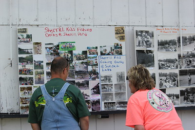 Charles Pritchard - Oneida Daily Dispatch People view the previous anglers and winners over the years at the 68th Annual Sherrill Kids Fishing Derby on Saturday, June 9, 2018.