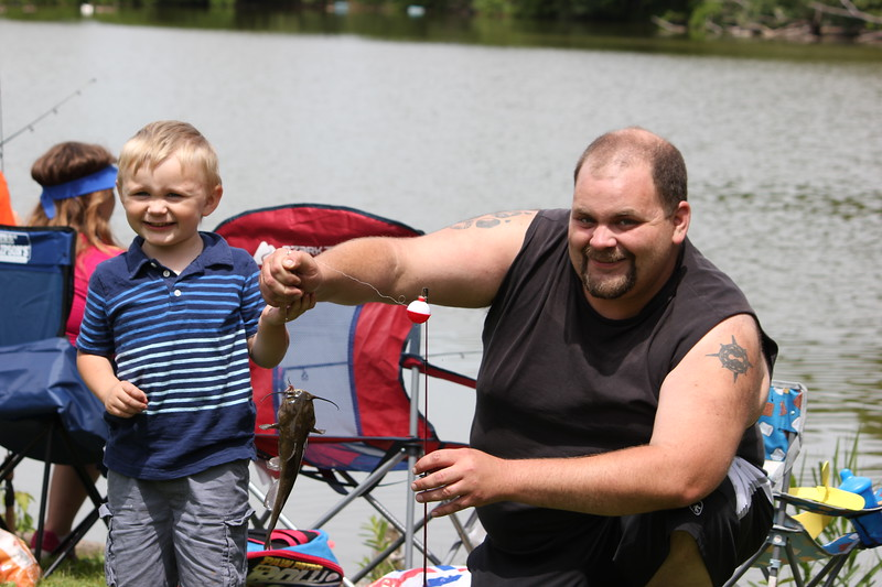 Charles Pritchard - Oneida Daily Dispatch Joshua Arvidson, 3, and his father Adam show off Joshua's fish at the 68th Annual Sherrill Kids Fishing Derby on Saturday, June 9, 2018.