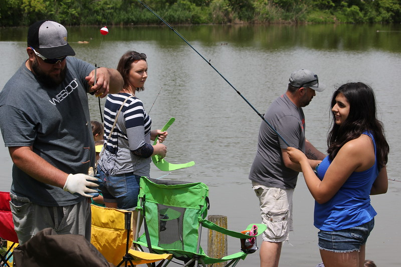 Charles Pritchard - Oneida Daily Dispatch Jasmin Smith, 13, of Vernon Center has her fish measured by on the judges at the 68th Annual Sherrill Kids Fishing Derby on Saturday, June 9, 2018.