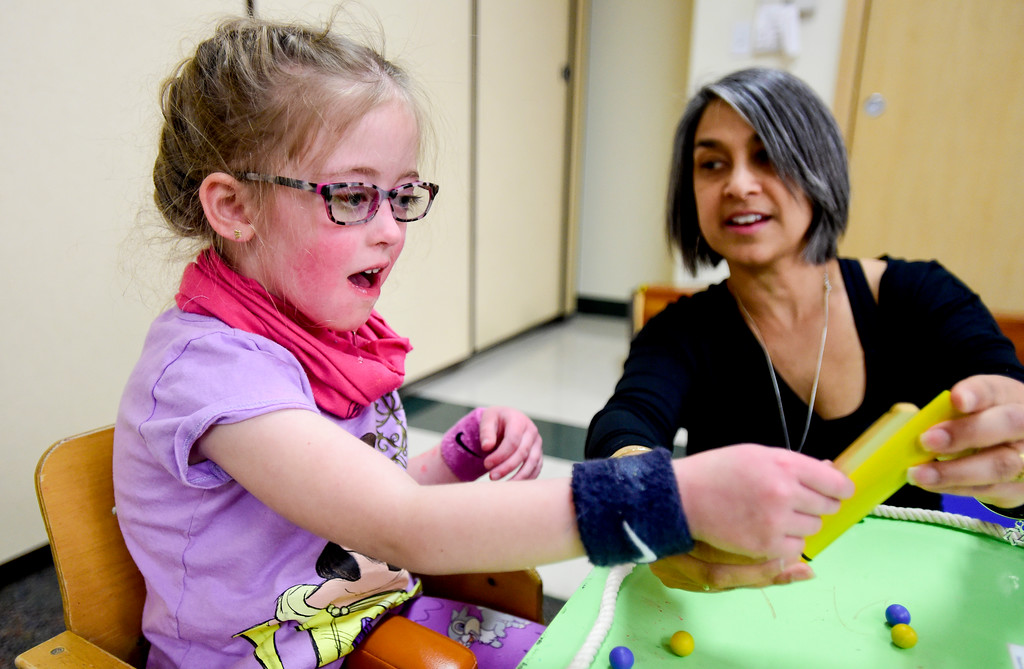 . Clara Shipp, 5, reacts to a puzzle while working with Occupational Therapist Shari Karmen at TLC Learning Center in Longmont, Colorado on March 1, 2018. Shipp has been chosen as the 2018 Happy Smackah beneficiary.  (Photo by Matthew Jonas/Staff Photographer)