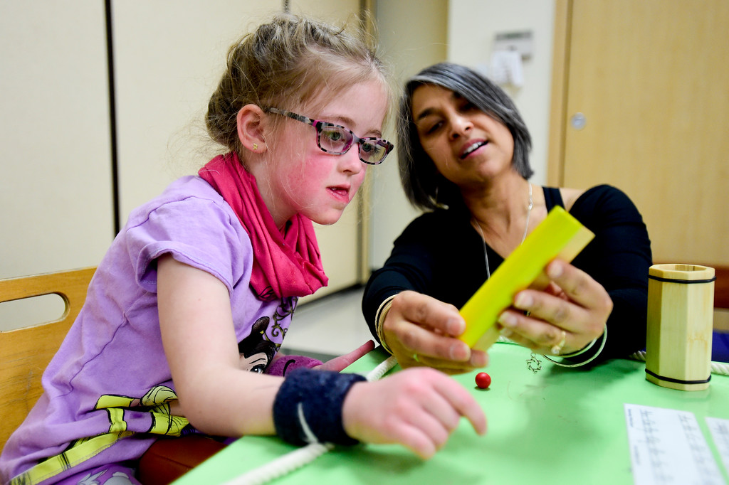 . Clara Shipp, 5, works with Occupational Therapist Shari Karmen at TLC Learning Center in Longmont, Colorado on March 1, 2018. Shipp has been chosen as the 2018 Happy Smackah beneficiary.  (Photo by Matthew Jonas/Staff Photographer)
