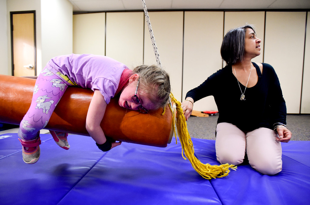 . Clara Shipp, 5, swings as Occupational Therapist Shari Karmen looks on at TLC Learning Center in Longmont, Colorado on March 1, 2018. Shipp has been chosen as the 2018 Happy Smackah beneficiary.  (Photo by Matthew Jonas/Staff Photographer)