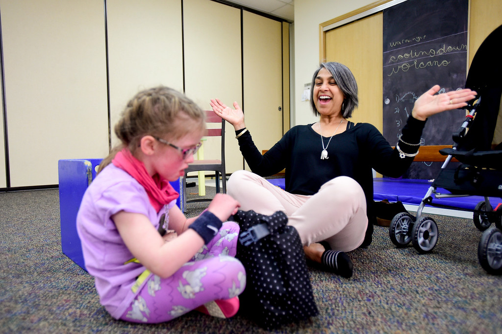 . Occupational Therapist Shari Karmen reacts to Clara Shipp, 5, successfully unclipping a lunch bag at TLC Learning Center in Longmont, Colorado on March 1, 2018. Shipp has been chosen as the 2018 Happy Smackah beneficiary.  (Photo by Matthew Jonas/Staff Photographer)
