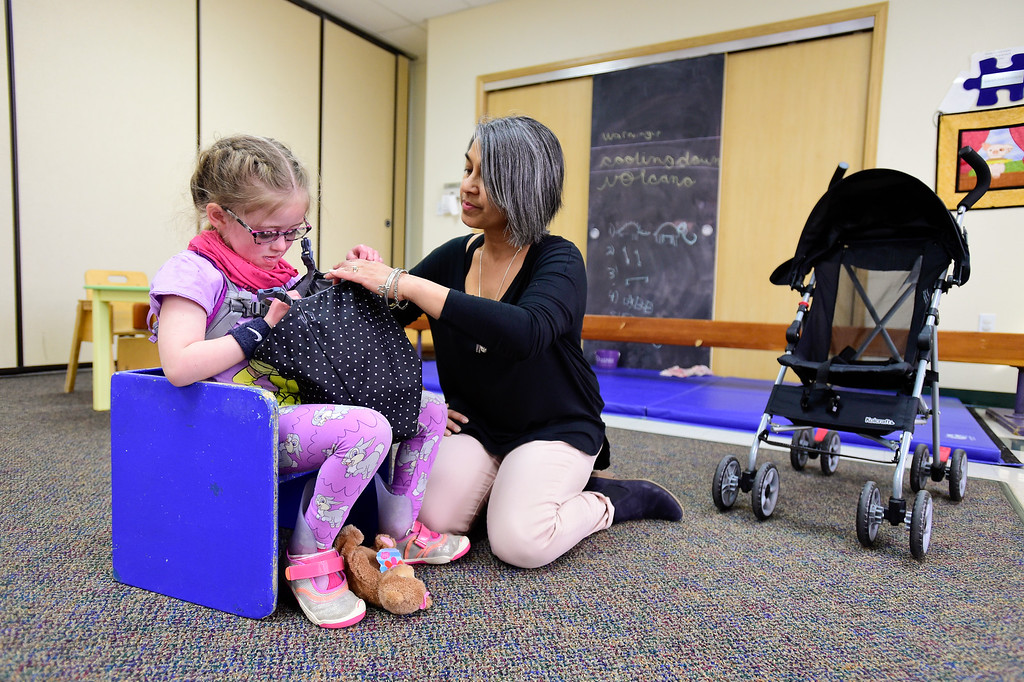 . Clara Shipp, 5, practices unclipping a lunch bag while working with Occupational Therapist Shari Karmen at TLC Learning Center in Longmont, Colorado on March 1, 2018. Shipp has been chosen as the 2018 Happy Smackah beneficiary.  (Photo by Matthew Jonas/Staff Photographer)