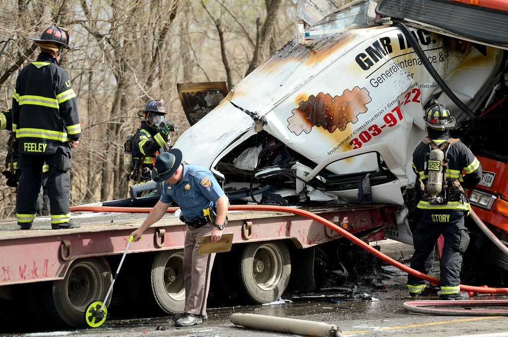 . Emergency personnel are seen working a 4 vehicle crash involving a bus, tractor trailer, van and car, on the 6600 Block of Arapahoe Avenue near Boulder on Monday. More photos: DailyCamera.com. Matthew Jonas/Staff Photographer March 20,  2017