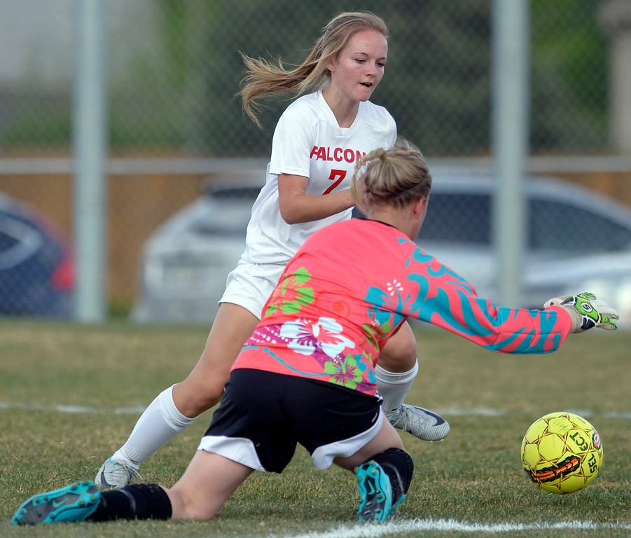 . Skyline\'s Whitney Parkinson pressures Berthoud goalkeeper Morgan Hughes in the first half Monday at Skyline High School. To view more photos visit bocopreps.com.  Lewis Geyer/Staff Photographer April 17, 2017
