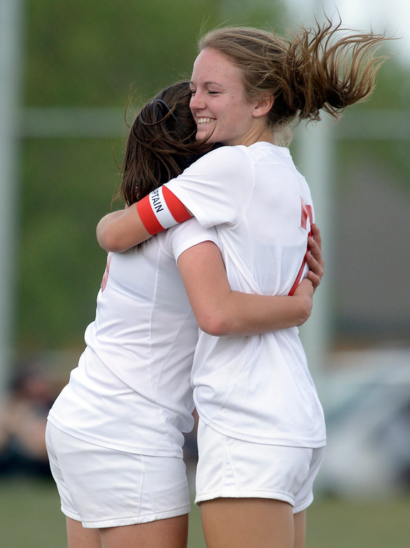 . Skyline\'s Whitney Parkinson, right, congratulates teammate Brie Musser after Musser scored against Berthoud in the first half Monday at Skyline High School. To view more photos visit bocopreps.com.  Lewis Geyer/Staff Photographer April 17, 2017