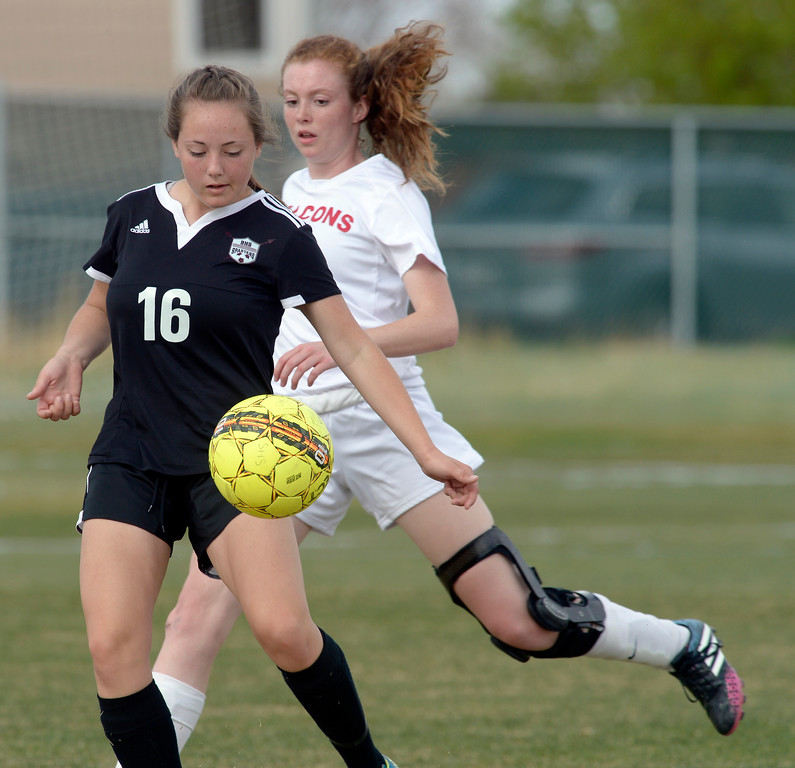 . Berthoud\'s Elizabeth Netschke moves the ball in front of Skyline\'s Maddie Lindauer in the first half Monday at Skyline High School. To view more photos visit bocopreps.com.  Lewis Geyer/Staff Photographer April 17, 2017