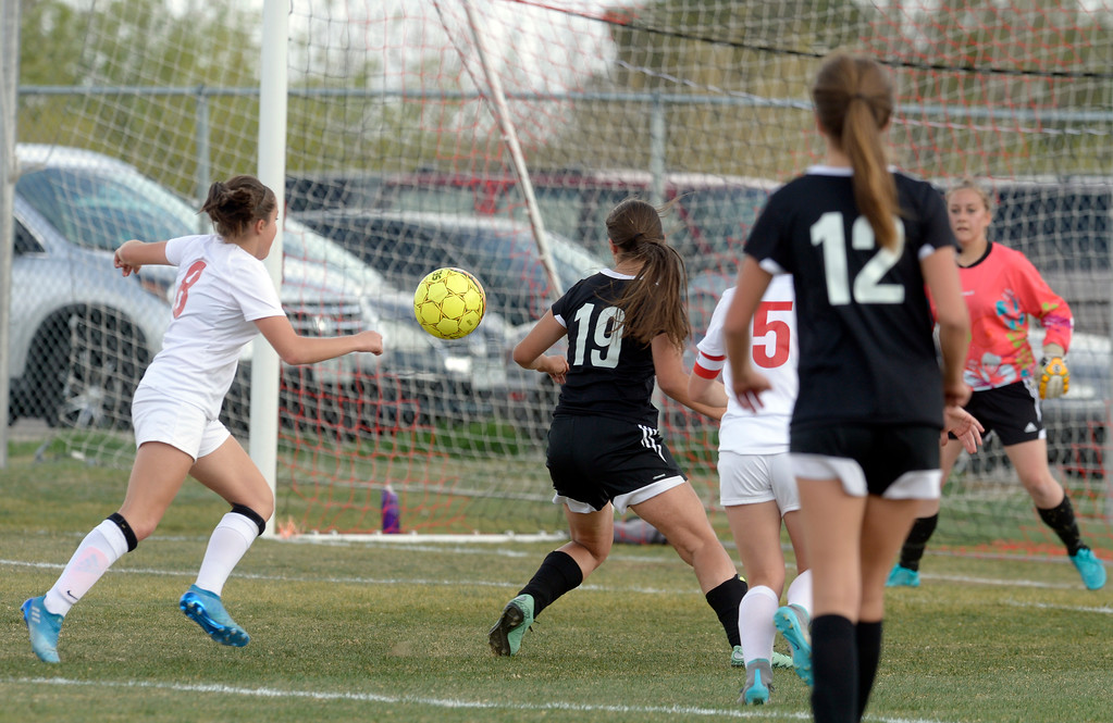 . Skyline\'s Brie Musser, left, moves in to score against Berthoud in the first half Monday at Skyline High School. To view more photos visit bocopreps.com.  Lewis Geyer/Staff Photographer April 17, 2017