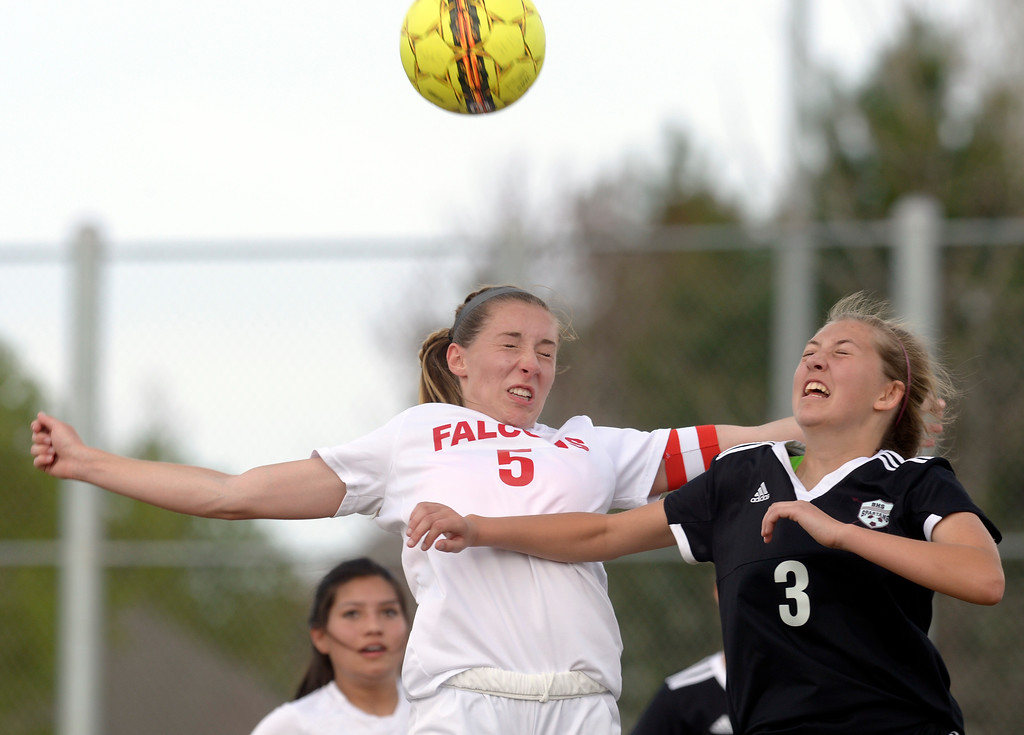. Skyline\'s Kalen Niedling and Berthoud\'s Chloe McIntosh try to make contact with a corner kick in the first half Monday at Skyline High School. To view more photos visit bocopreps.com.  Lewis Geyer/Staff Photographer April 17, 2017